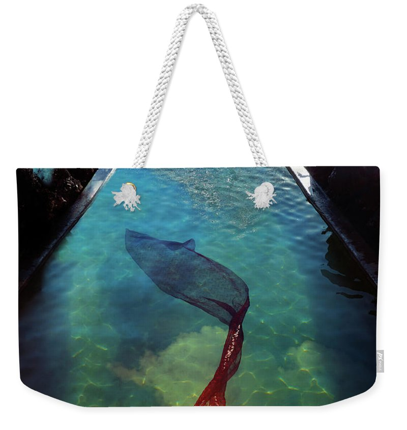 Human Arm Weekender Tote Bag featuring the photograph Pacific Islander Woman In Mermaid by Colin Anderson Productions Pty Ltd