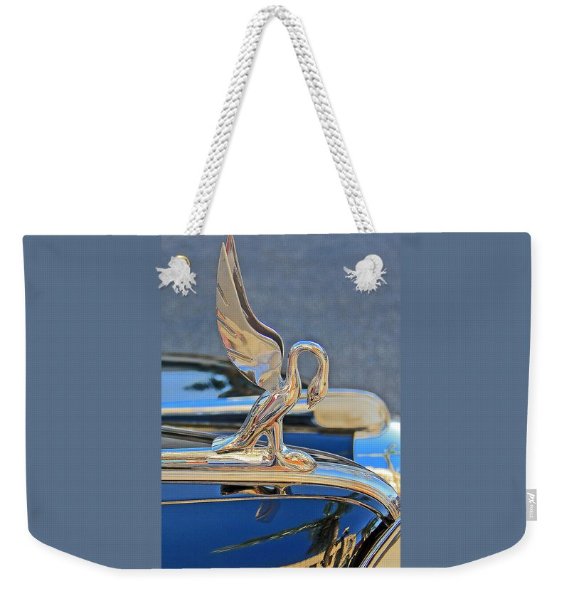 Car Weekender Tote Bag featuring the photograph Packard Hood Ornament by Ben and Raisa Gertsberg
