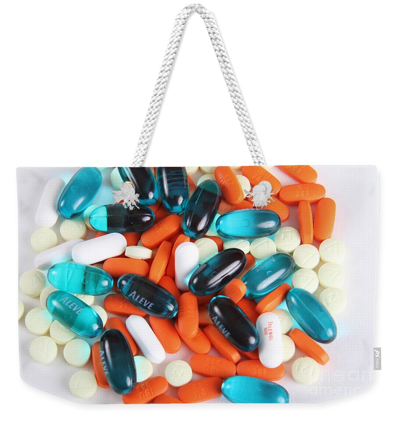 Over The Counter Weekender Tote Bag featuring the photograph Pain Medication by Photo Researchers, Inc.