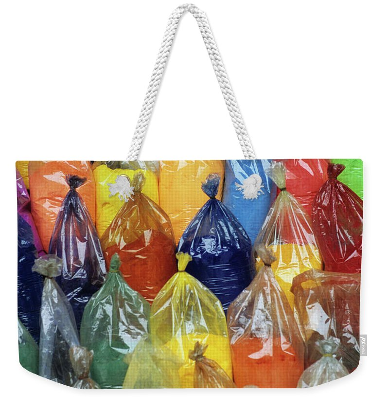 Vietnam Weekender Tote Bag featuring the photograph Paint Pigment by Rick Piper Photography