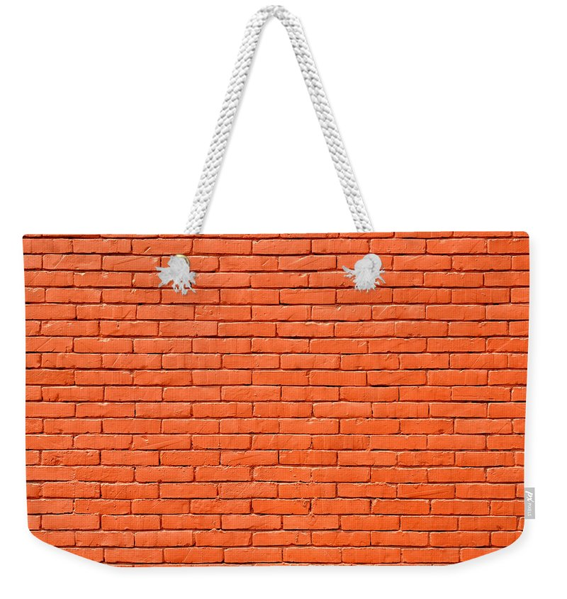 Brick Weekender Tote Bag featuring the photograph Painted Brick Wall by Dutourdumonde Photography