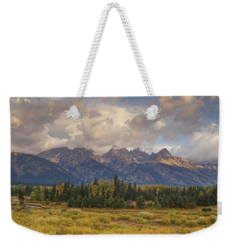 North America Weekender Tote Bag featuring the photograph Panaroma Clearing Storm On A Fall Morning In Grand Tetons National Park by Dave Welling