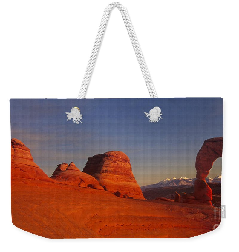 America Weekender Tote Bag featuring the photograph Panorama Moonrise Over Delicate Arch Arches National Park Utah by Dave Welling