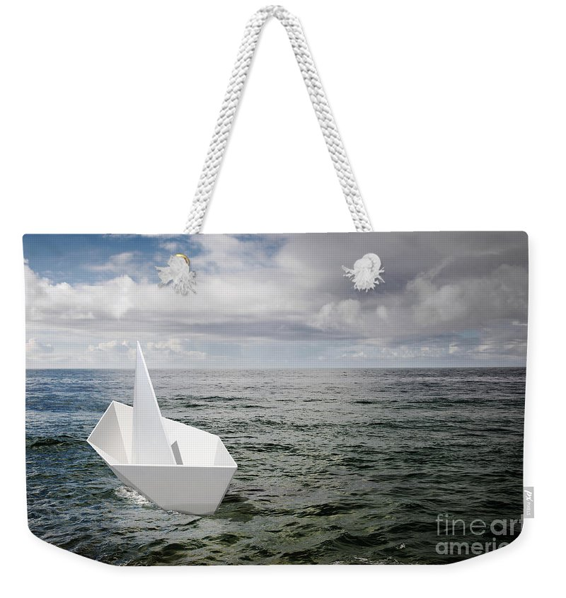 Abstract Weekender Tote Bag featuring the photograph Paper Boat by Carlos Caetano