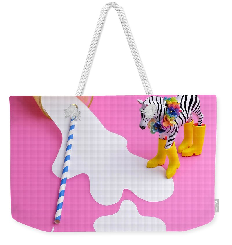 Milk Weekender Tote Bag featuring the photograph Paper Craft Glass Of Spilled Milk With by Juj Winn
