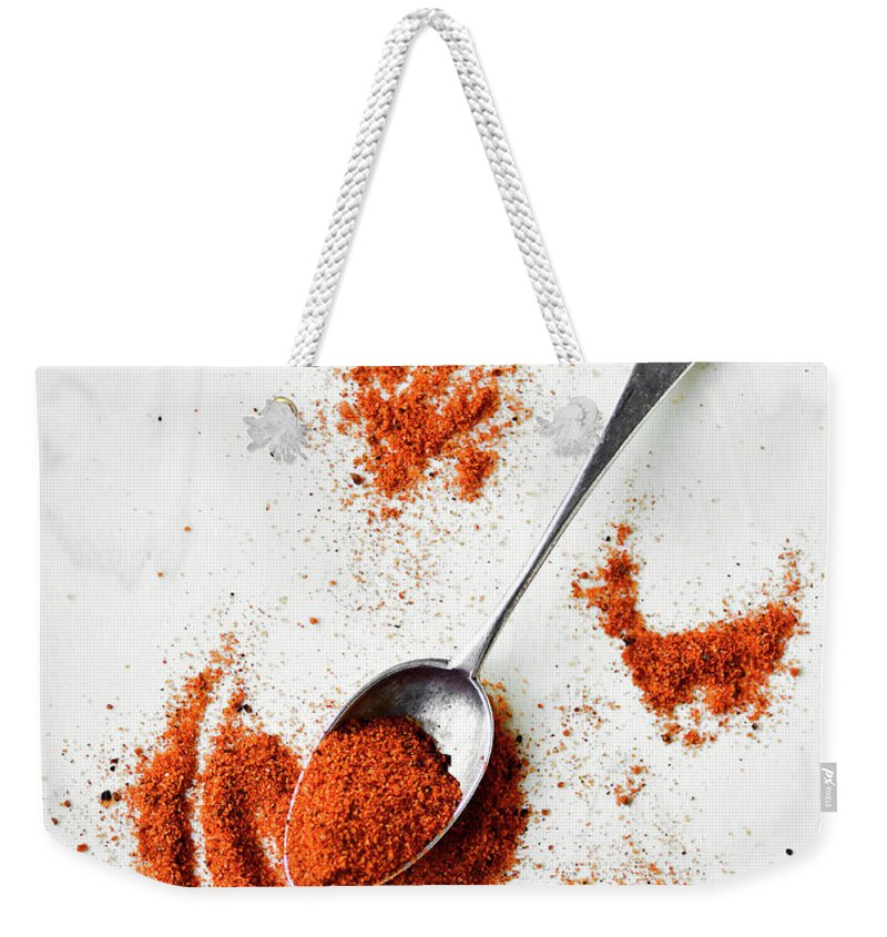 Atlanta Weekender Tote Bag featuring the photograph Paprika Powder In A Spoon by Natalia Ganelin