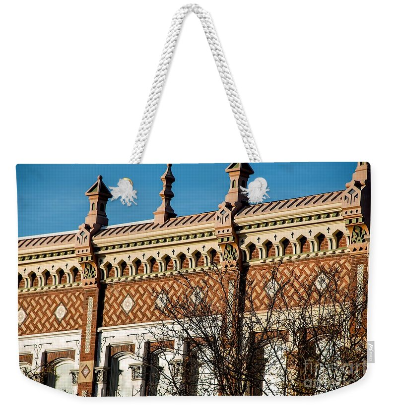 Building Weekender Tote Bag featuring the photograph Parapet by Joseph Yarbrough