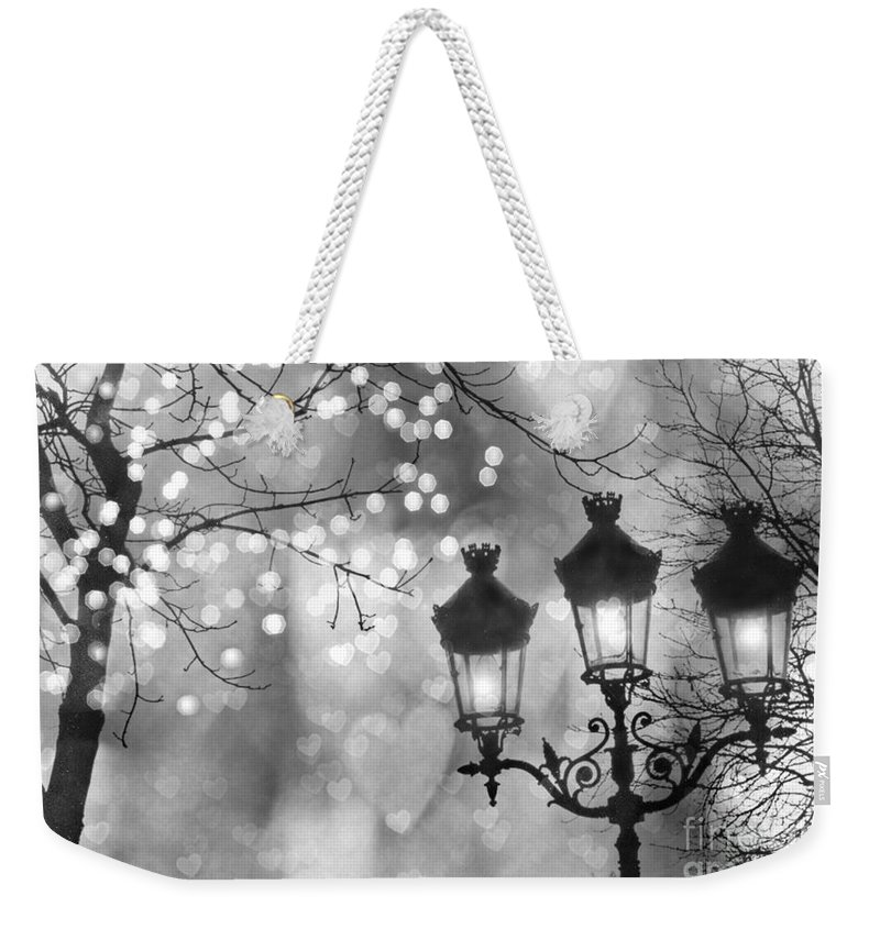 Paris Weekender Tote Bag featuring the photograph Paris Christmas Sparkle Lights Street Lanterns - Paris Holiday Street Lamps Black And White Lights by Kathy Fornal