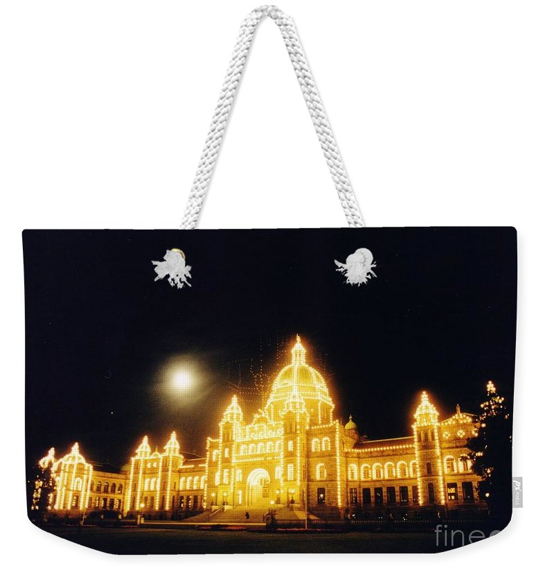Dramatic Lighting Weekender Tote Bag featuring the photograph Parliment Building Victoria by John Malone