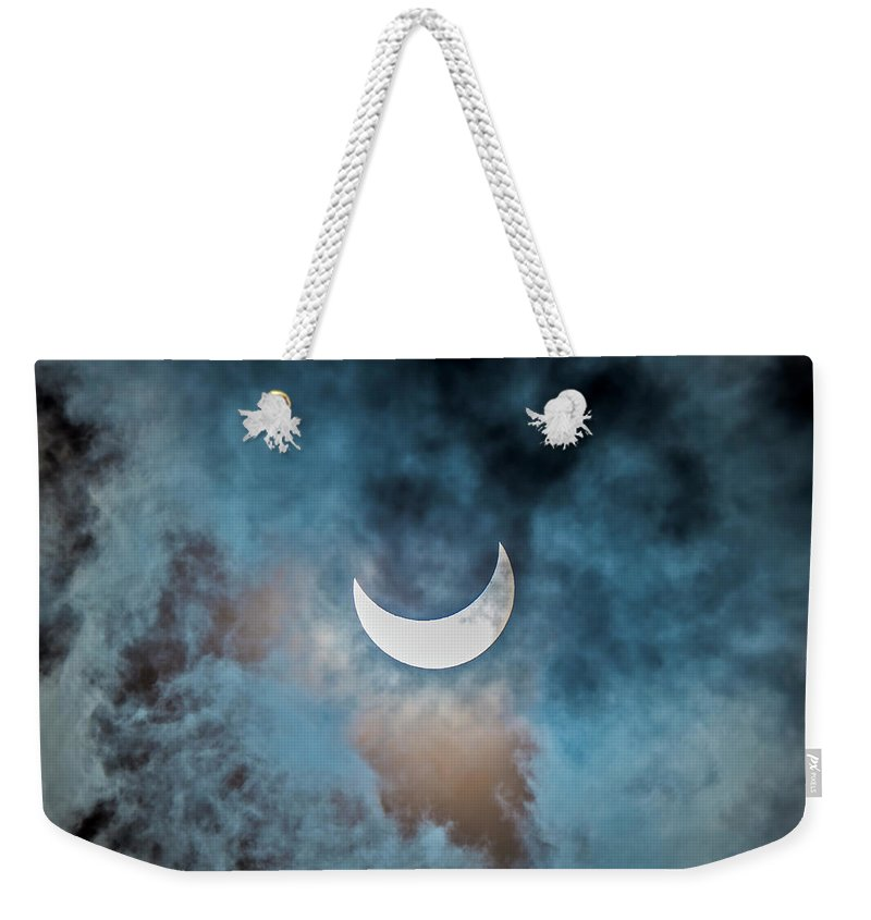 2014 Weekender Tote Bag featuring the photograph Partial Solar Eclipse In Cloud 1 Oct by Alan Dyer