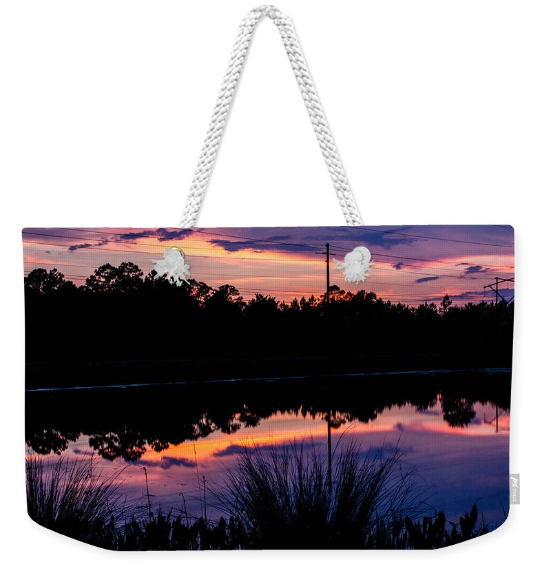 Weekender Tote Bag featuring the photograph Pastels by Tyson Kinnison