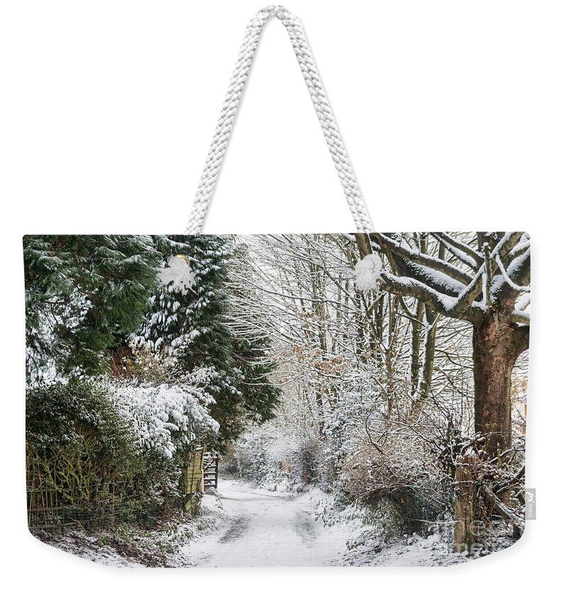 Snowy Path Weekender Tote Bag featuring the photograph Path Through The Snow by Ann Garrett