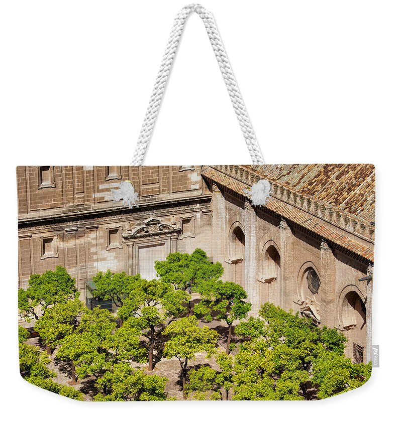 Garden Weekender Tote Bag featuring the photograph Patio De Los Naranjos Of Seville Cathedral by Artur Bogacki
