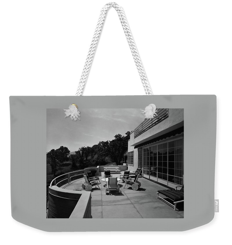 Exterior Weekender Tote Bag featuring the photograph Paved Terrace At The Residence Of Mr. And Mrs by Clyde H. Sunderland