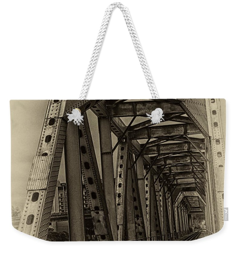Paving The Way Forward Weekender Tote Bag featuring the photograph Paving The Way Forward by David Millenheft
