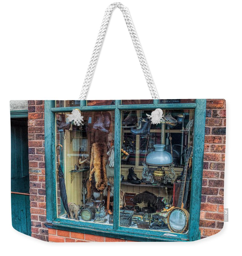 Pawnbroker Weekender Tote Bag featuring the photograph Pawnbrokers Shop by Adrian Evans