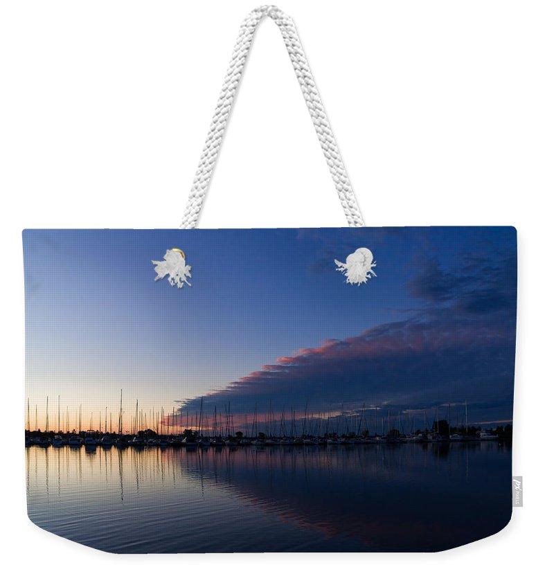 Sailboat Weekender Tote Bag featuring the photograph Peaceful Yachts And Sailboats by Georgia Mizuleva