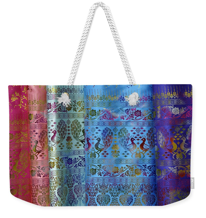 Asia Weekender Tote Bag featuring the photograph Peacocks On Silk by Michele Burgess