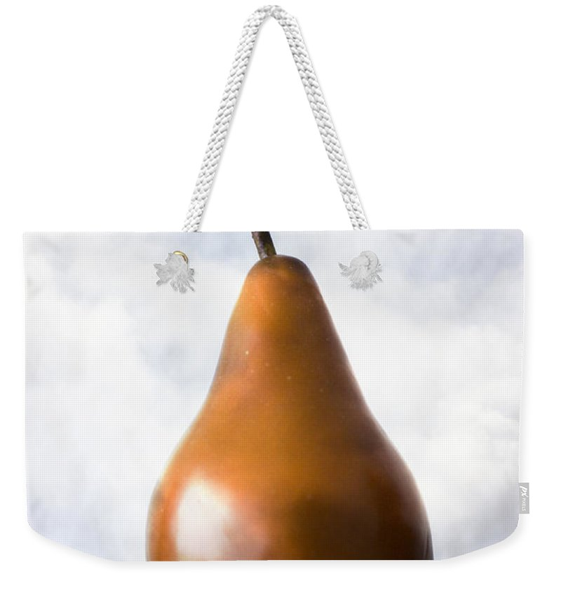 Pear Weekender Tote Bag featuring the photograph Pear In The Clouds by Carol Leigh