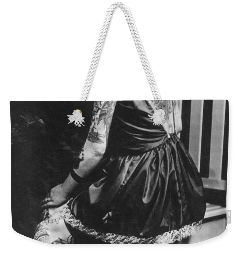 Photographs Weekender Tote Bag featuring the photograph Tattoo Woman by Larry Mora