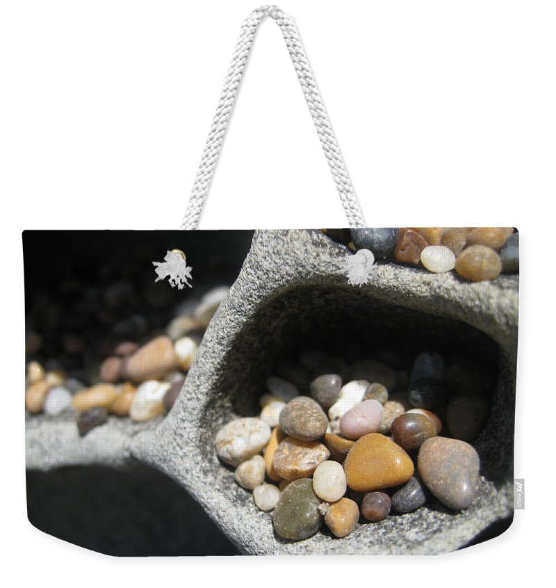 Nature Weekender Tote Bag featuring the photograph Pebble Beach Mankala by Noa Mohlabane