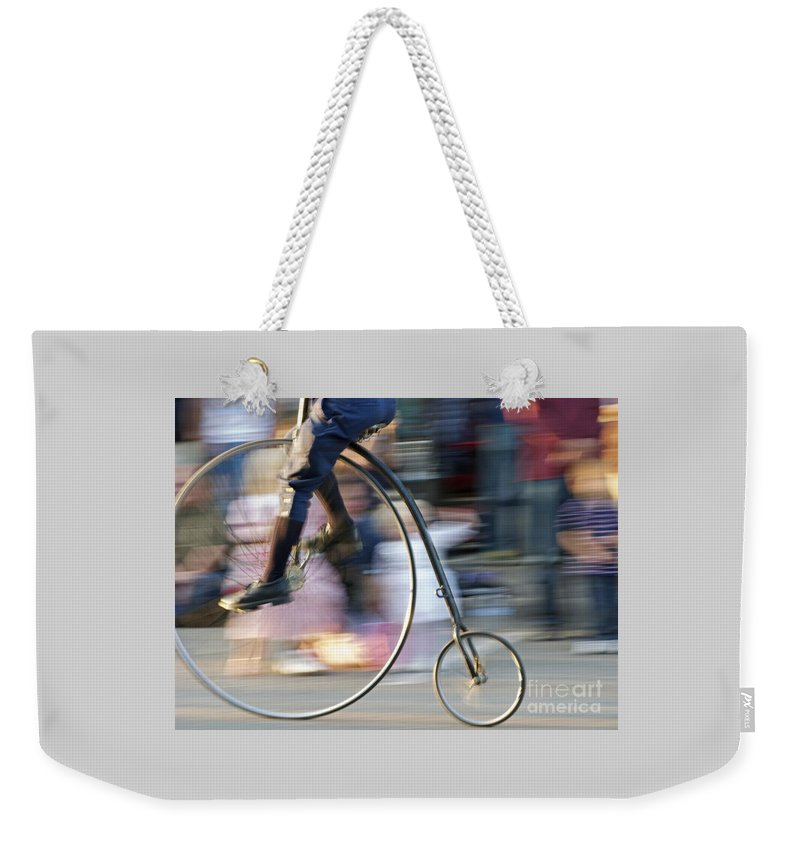 Bicycle Weekender Tote Bag featuring the photograph Pedaling Past by Ann Horn