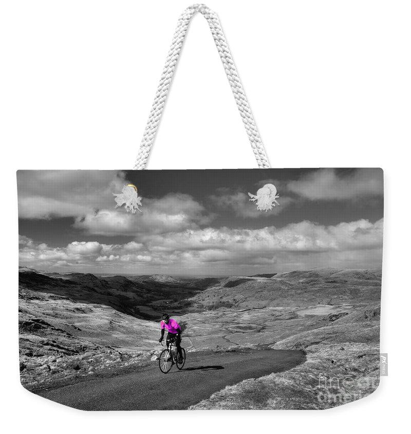 Hardknot Weekender Tote Bag featuring the photograph Pedalling The Pass In Pink by Rob Hawkins
