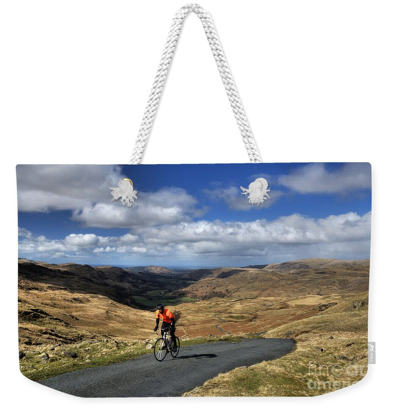 Hardknot Weekender Tote Bag featuring the photograph Pedalling The Pass by Rob Hawkins