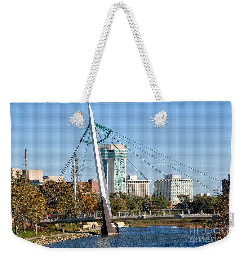 Arkansas River Weekender Tote Bag featuring the photograph Pedestrian Bridge Over Arkansas River In Wichita by Bill Cobb