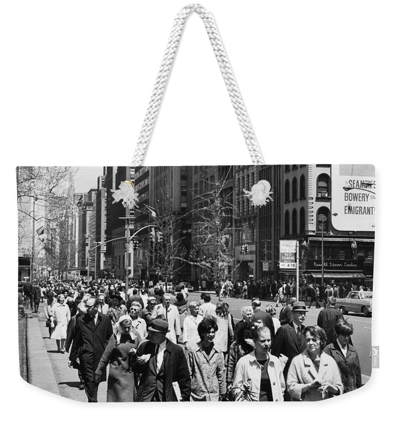 1960 Weekender Tote Bag featuring the photograph Pedestrians In New York by Underwood Archives