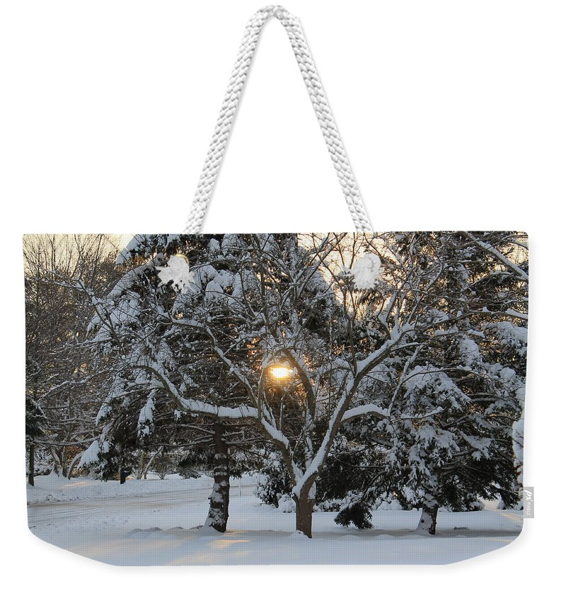 Sun Rising Weekender Tote Bag featuring the photograph Peek A Boo Sun by Catie Canetti