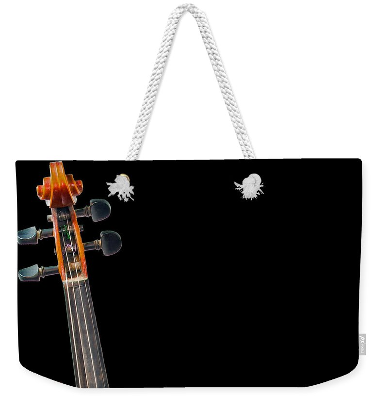 Pegs And Scroll Weekender Tote Bag featuring the photograph Pegs And Scroll by Torbjorn Swenelius