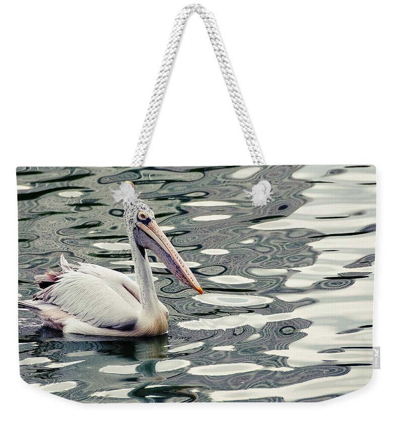 Colombo Weekender Tote Bag featuring the photograph Pelican With Abstract Water Reflections I by Jenny Rainbow