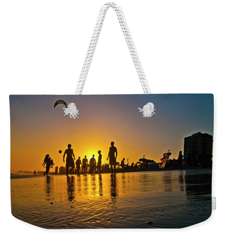 Parachuting Weekender Tote Bag featuring the photograph People Having Fun In The Beach by Giovani Cordioli
