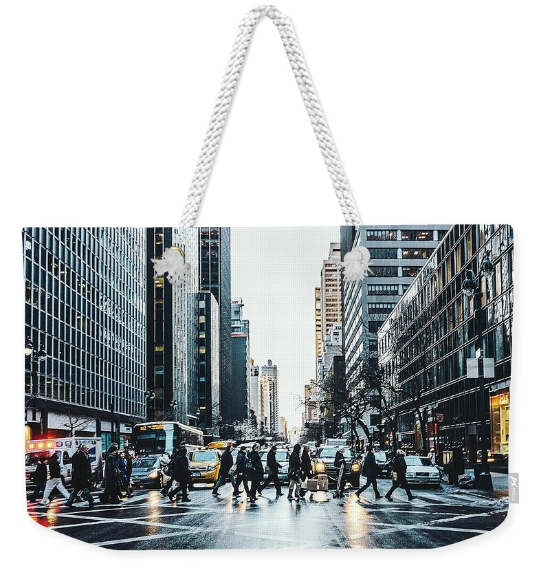 Pedestrian Weekender Tote Bag featuring the photograph People Walking On City Street by Sven Hartmann / Eyeem