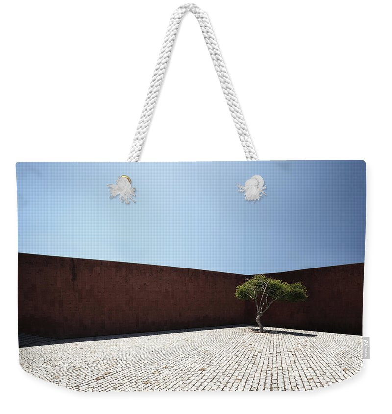 City Weekender Tote Bag featuring the photograph Perspective View On Square With Tree by Stanislaw Pytel