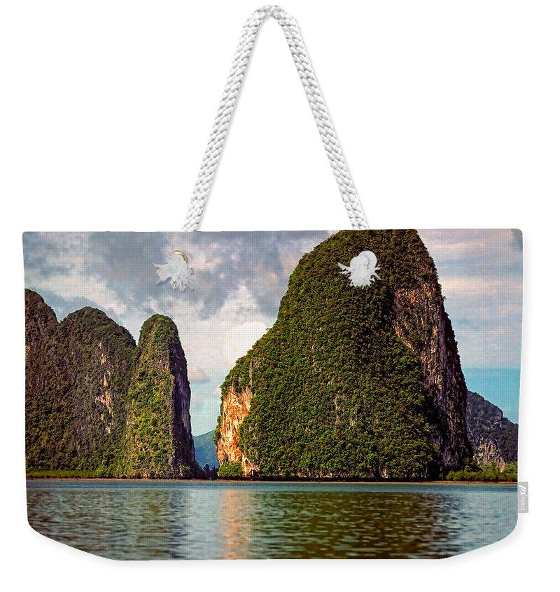 Phang Nga Bay Weekender Tote Bag featuring the photograph Phang Nga Bay by Steve Harrington