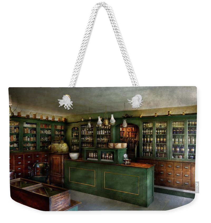 Apothecary Weekender Tote Bag featuring the photograph Pharmacy - The Chemist Shop by Mike Savad