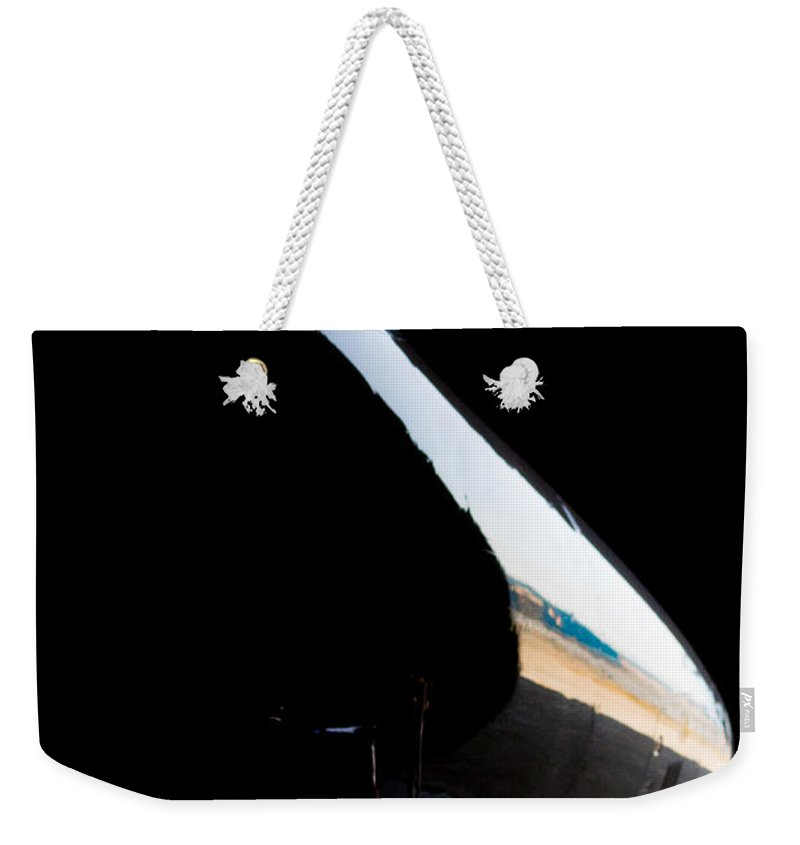 Embraer Phenom 100 Weekender Tote Bag featuring the photograph Phenom Reflection by Paul Job
