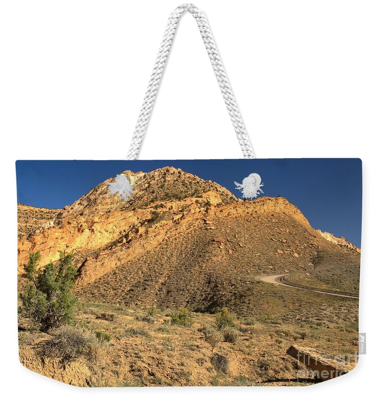 Cottonwood Road Weekender Tote Bag featuring the photograph Piece Of The Coxcomb by Adam Jewell