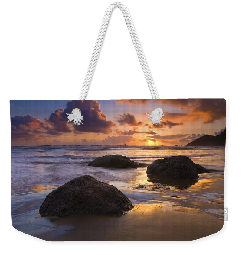 Sunset Weekender Tote Bag featuring the photograph Pieces Of Eight by Mike Dawson