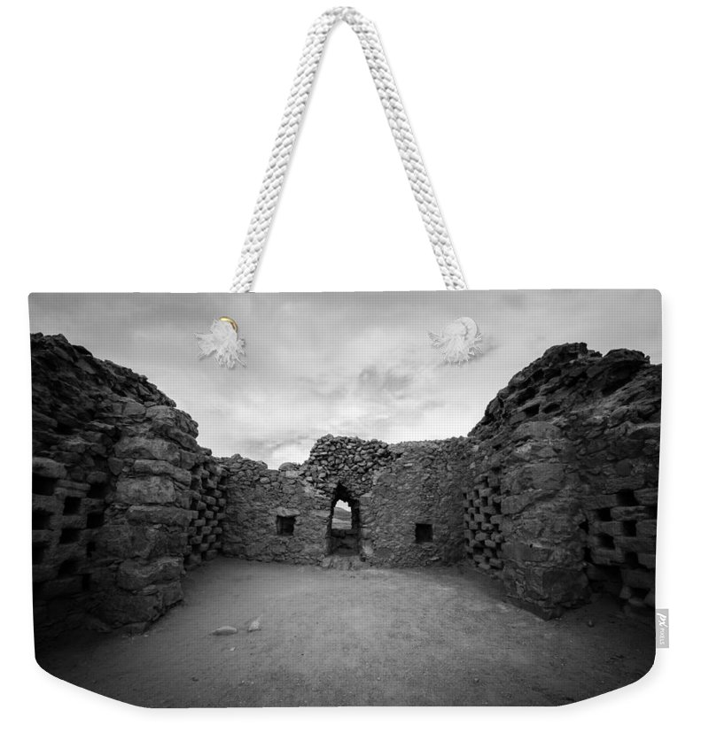 Black And White Weekender Tote Bag featuring the photograph Pigeon Penthouse At Masada by David Morefield