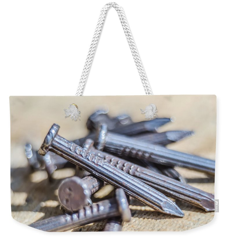Pile Weekender Tote Bag featuring the photograph Pile Of Nails Macro by Alex Grichenko