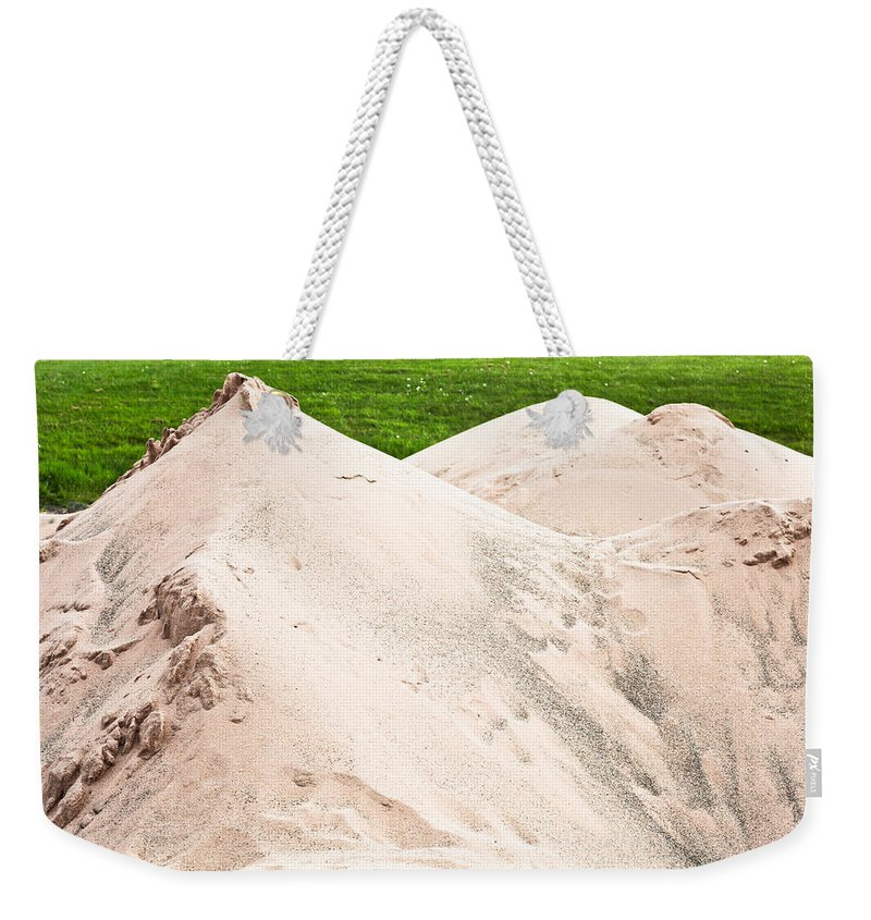 Beach Weekender Tote Bag featuring the photograph Pile Of Sand by Tom Gowanlock