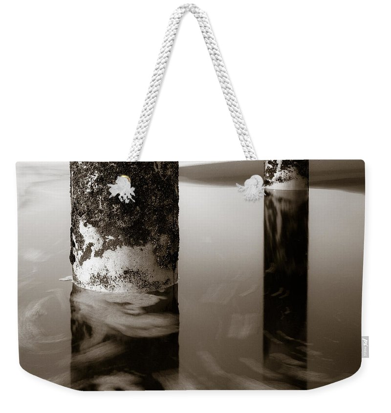Seascape Weekender Tote Bag featuring the photograph Pillars And Swirls by Dave Bowman