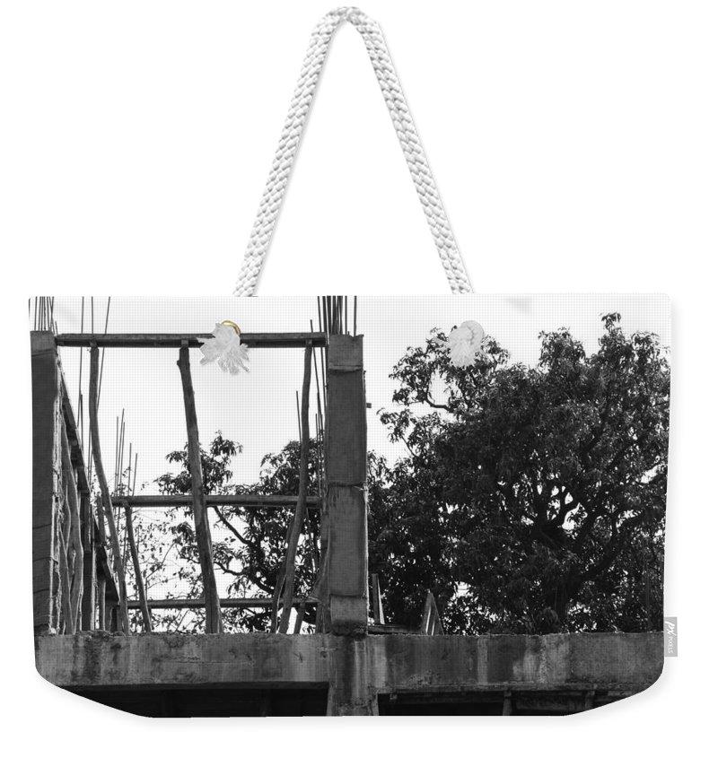 Bamboo Weekender Tote Bag featuring the photograph Pillars Of An Under Construction Building Covered By Sacks by Ashish Agarwal