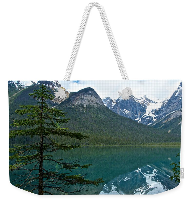 Pine Over Emerald Lake Reflection From Emerald Lake Trail In Yoho Np Weekender Tote Bag featuring the photograph Pine Over Emerald Lake Reflection In Yoho National Park-british Columbia-canada by Ruth Hager