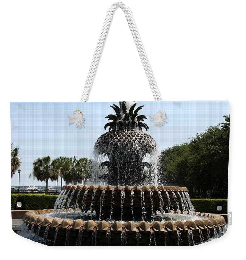 Fountain Weekender Tote Bag featuring the photograph Pineapple Fountain Charleston River Park by Christiane Schulze Art And Photography