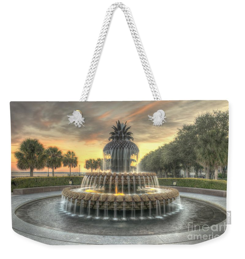 Pineapple Fountain Weekender Tote Bag featuring the photograph Pineapple Fountain Sunset by Dale Powell