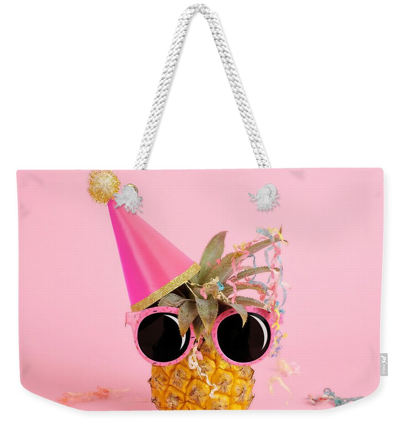 Celebration Weekender Tote Bag featuring the photograph Pineapple Wearing A Party Hat And by Juj Winn